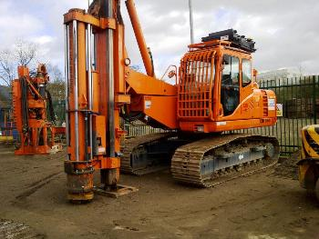 CZM EM400H with Fambro HR2000 impact hammer back driving sheet piles