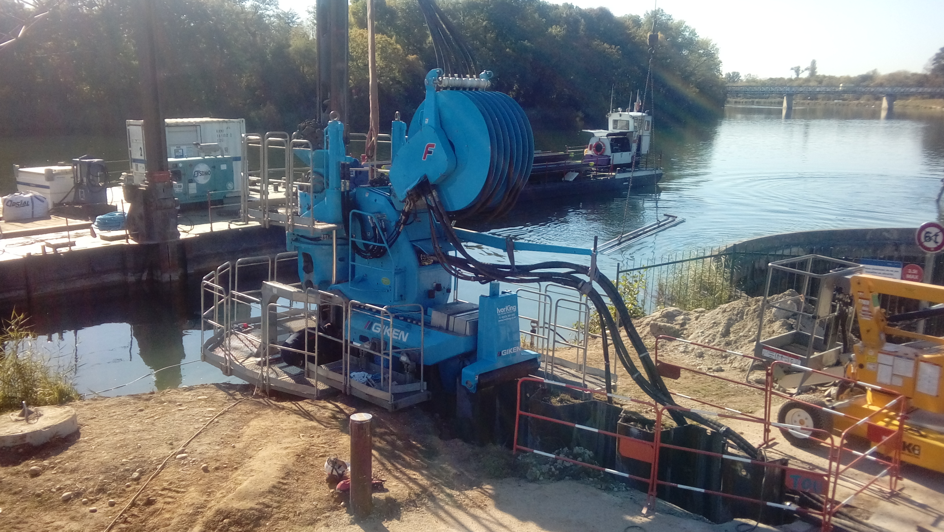 Giken F301 super crush piler recently sold to Ivor King Piling at work installing 12.5 m long PU28 sheet piles in Lyon, France through dense sands.  The piles are being installed to protect a 150 year old wall that protects the river from flooding, and mo